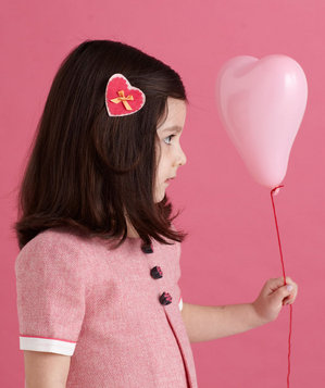 Girl wearing heart-shaped hairpin