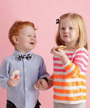 Kids eating Valentine's Day cookies