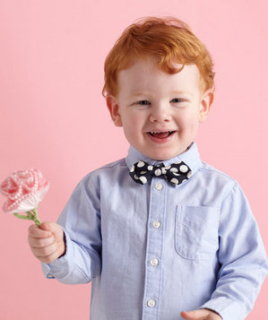 Little boy holding a paper flower