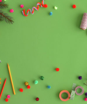 Craft materials on a green background