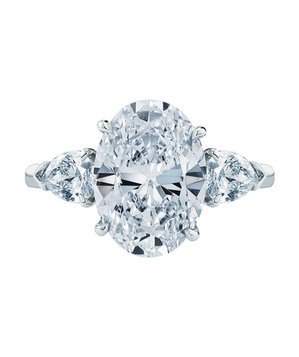 Kwiat Oval Diamond and Platinum Ring with Two Pear Shapes