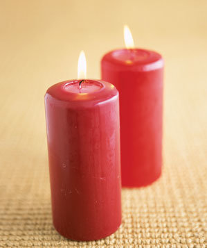 Lit red candles on rug