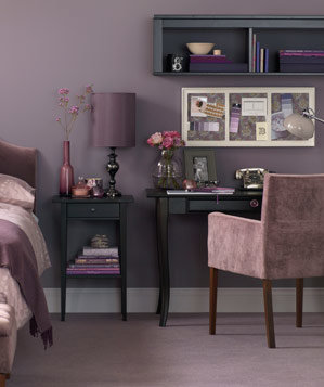 Bedroom with work space in hues of purple