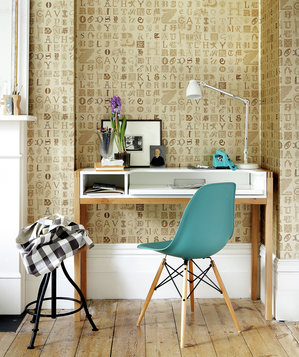 Desk with turquoise chair and letterpress wallpaper