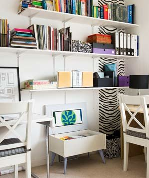 Corner home office with 2 desks and zebra accents