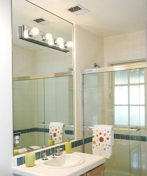 Bathroom sink area with ventilator fan