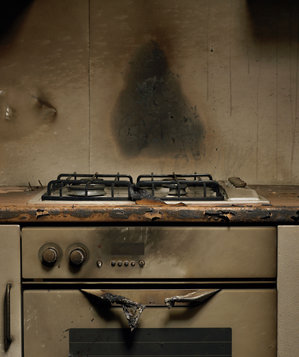 Damaged kitchen stove after fire
