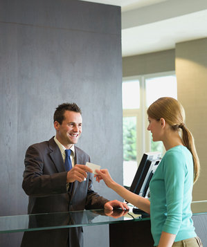 Woman checking into a hotel