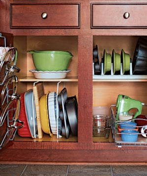 Organized bakeware in wood kitchen cabinets