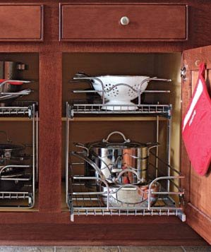 Organized Pots And Pans In Wood Kitchen Cabinets