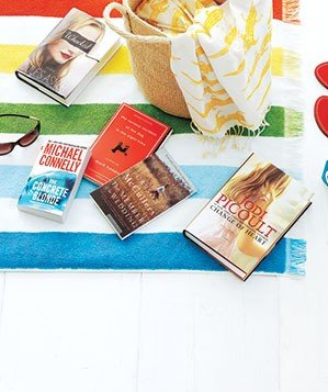 Books on a beach blanket