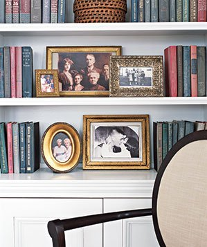 Bookshelf with framed photos