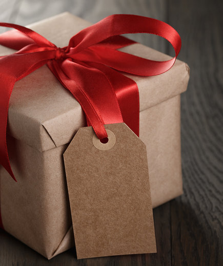 Gift box with kraft paper and red bow