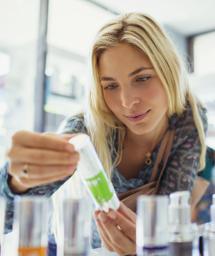 Woman Looking through Skincare Products