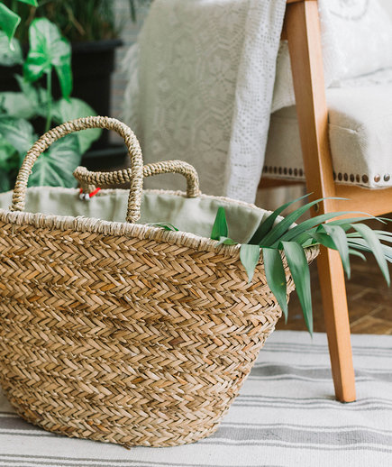 Straw Bag on the Floor With Leaf in it