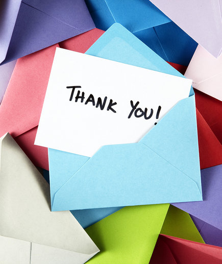 Thank you note surrounded by envelopes