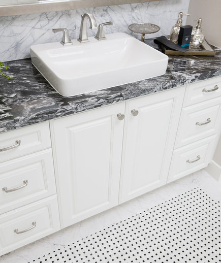 Bathroom sink with white cabinet