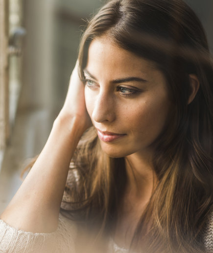 woman-thinking-wondow-pensive