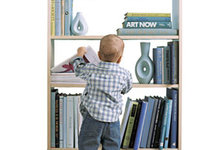 toddler-standing-bookcase