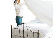 woman-making-bed