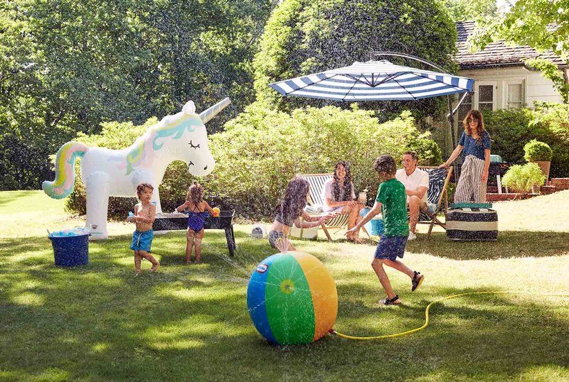 10 Ideas to Turn a Boring Backyard into a Water Park (No Pool Necessary)