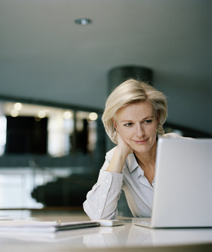 woman-sitting-office-laptop