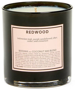 boy-smells-redwood-scented-candle