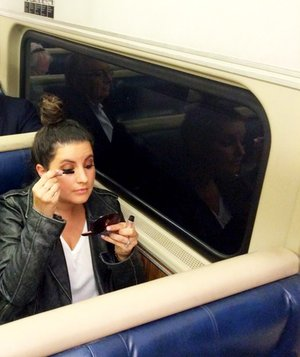 applying-makeup-on-train