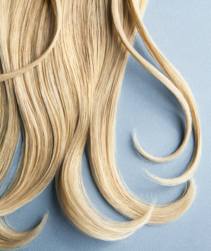 blond-hair-blue-background
