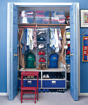 Design With Time Savers Blue Kid Closet Organized