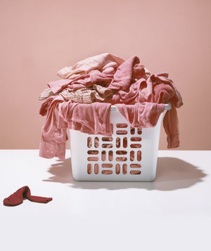 Basket of laundry dyed pink