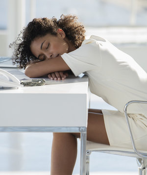 woman-napping-on-desk