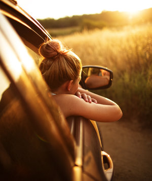 girl-car-window-road-trip