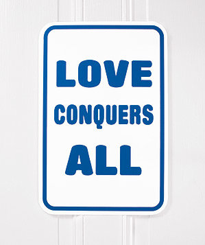 love-conquers-sign