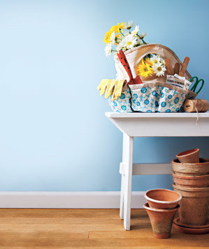 blue-wall-gardening-supplies-white-table