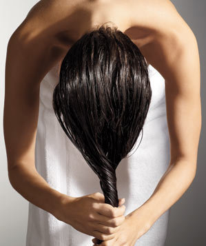 woman-ringing-out-wet-hair