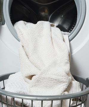 Dryer with towels and laundry basket
