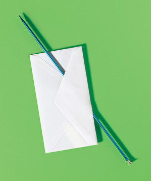 knitting-needle-used-to-open-an-envelope
