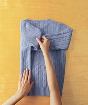 step 2 how to fold a sweater real simple. Black Bedroom Furniture Sets. Home Design Ideas