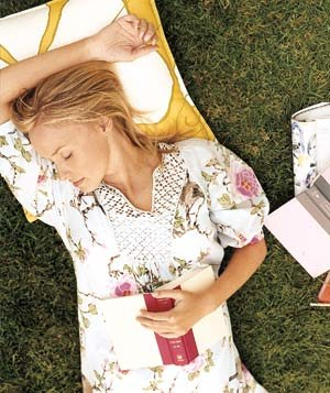 woman-sleeping-outside-book-hand