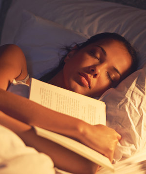 woman-sleeping-book
