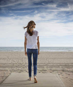 woman-walking-beach-boardwalk