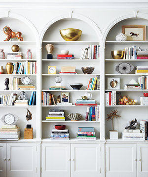 white-bookcase-with-books-and-assorted-objects-on-the-shelves