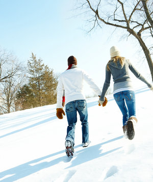 couple-walking-snow