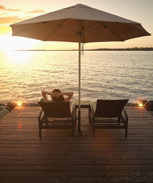 woman-relaxing-alone-sunset