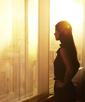 woman-window-sun-city