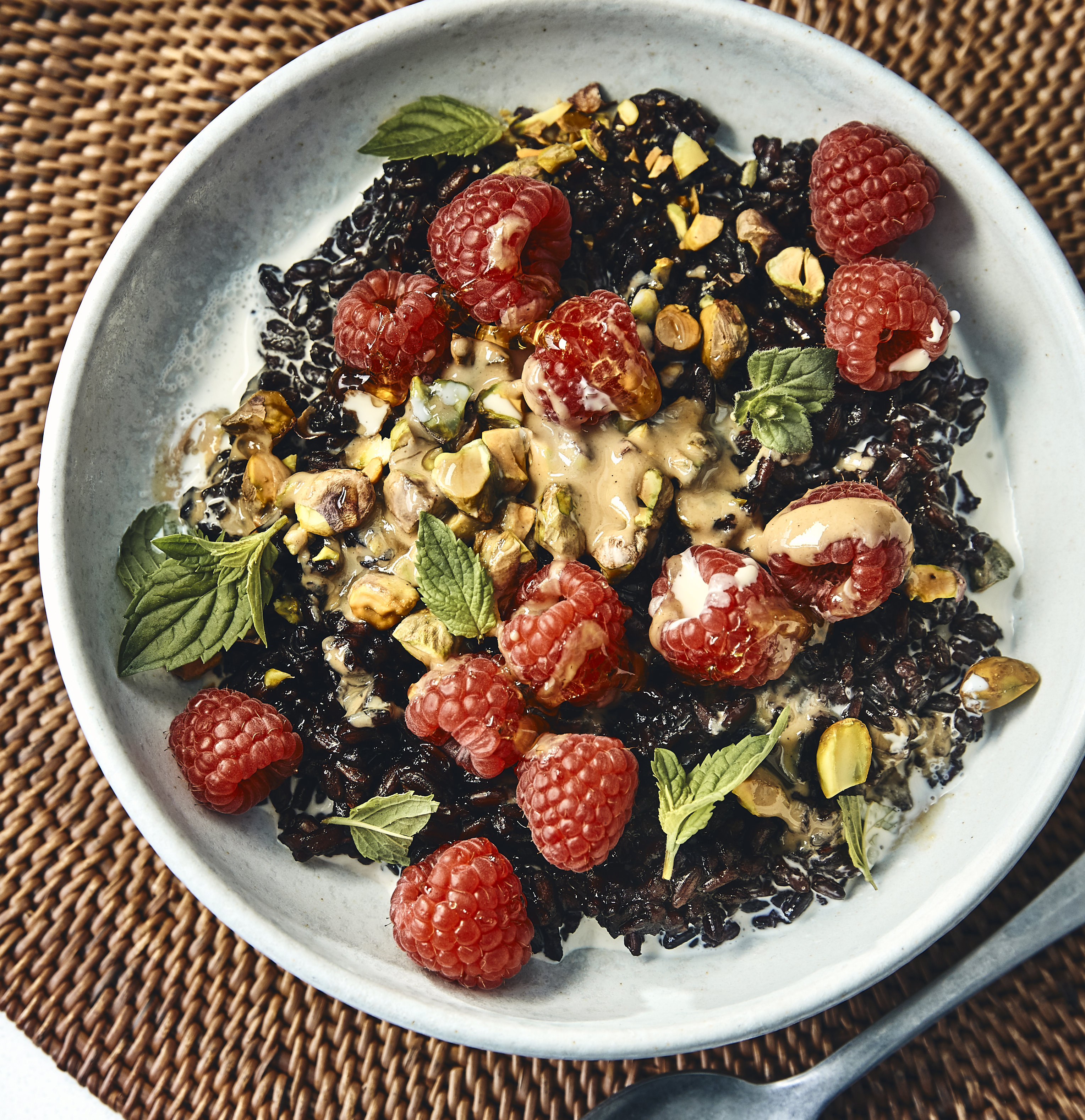 Black Rice Bowl With Tahini, PIstachios, and Raspberries
