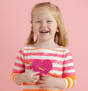 Girl holding heart-shaped Valentine treat