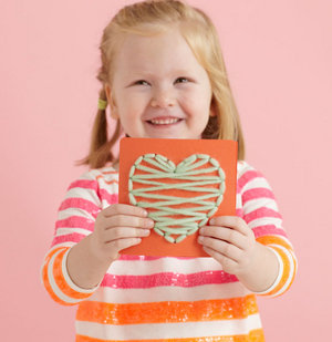 Girl with sewn Valentine's Day card