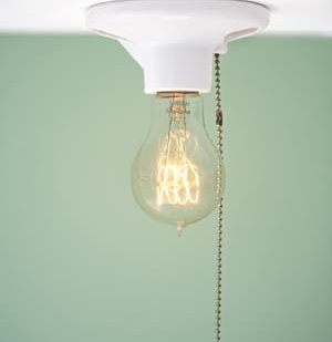 Clear incandescent light bulb turned on